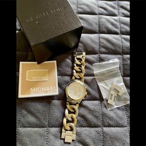 Michael Kors Silver and Gold bracelet Watch.